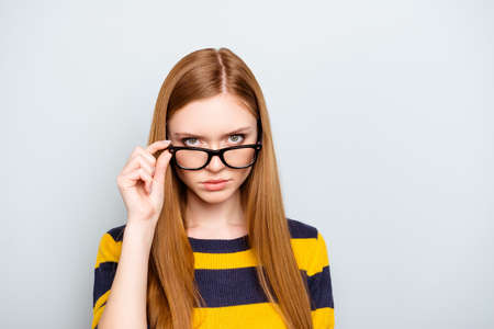 Boss employment university campus knowledge concept. Close up portrait of confident serious concentrated focused astonished shocked teenager touching glasses isolated on gray background copy-space Stock Photo
