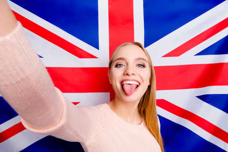 International europe style stylish people careless restless lifestyle leisure concept. Close up portrait of excited cheerful comic joking blogger demonstrating tongue taking making selfie