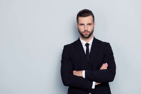 People leadership profession official concept. Portrait of serious concentrated focused confident severe handsome expert experienced qualified instructor with crossed arms isolated on gray background