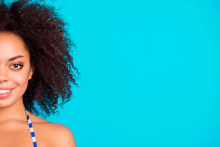 Close up cropped portrait of cheerful smiling beautiful attractive charming afro lady with curly hair, isolated on bright blue background