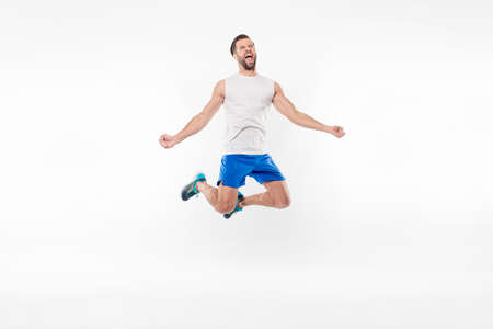 I did it!!! Strong, crazy, attractive, professional, sporty, cheerful, positive man yelling, celebrating victory in competition, isolated on white background