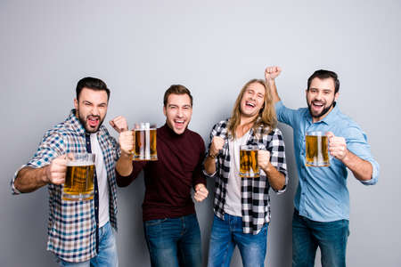 Nightlife leisure lifestyle masculitity game fan support screaming spectator concept. Four funny funky cheerful grimacing gesturing guys, casual clothes, watching game isolated on gray background