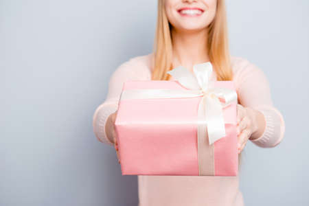 Style stylish trendy people person sale discount concept. Cropped portrait of cute sweet lovely adorable excited cheerful toothy beaming smile girl giving you a present isolated on gray background
