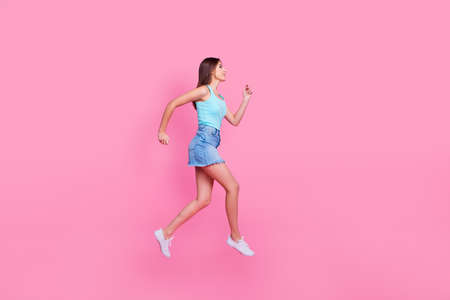 I need to buy something! Full-size full-length view profile side photo of attractive excited cute lovely charming woman in a hurry, isolated on pink background