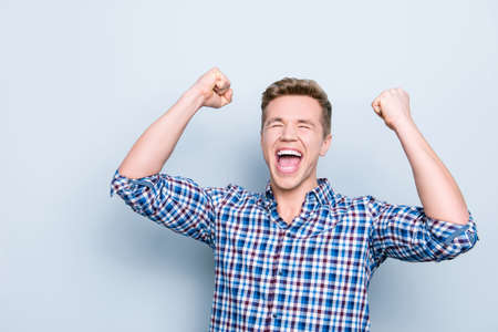 Exams pass lottery people weekend business stylish party bachelor holidays fortune concept. Portrait of excited astonished amazed rejoicing shouting person raising fists up isolated on gray background Stock Photo