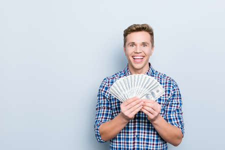 Customer buy buyer  savings currency people person concept. Portrait of excited amazed wondered astonished cheerful rejoicing manager showing many banknotes isolated on gray background copyspace