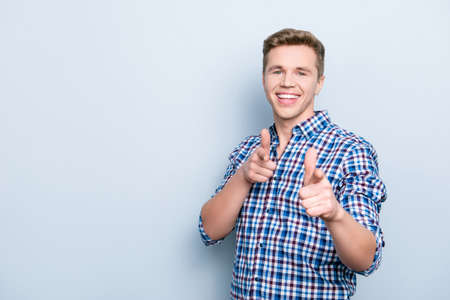 Portrait of charismatic confident cheerful excited handsome toothy beaming enthusiastic delightful  swag promoter agent pointing on you with forefingers isolated on gray background checkered shirt