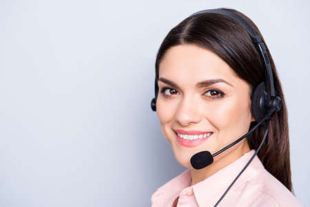 Close up portrait with copy space empty place of pretty cute friendly cheerful positive woman with headset microphone on head isolated over grey background looking at camera, advertisement concept Banque d'images - 103448786