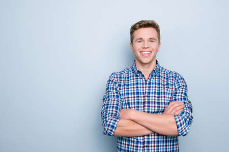 People lifestyle person marketer model employment concept. Portrait of friendly cheerful handsome confident clever smart rejoicing man standing with crossed arms isolated on gray background copy-space
