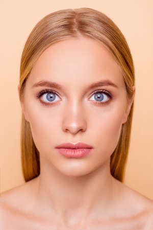 Close up vertical portrait of cute, pretty, charming girl having dry oiled face problem skin, treatment therapy healthcare health wellness wellbeing concept isolated on beige background