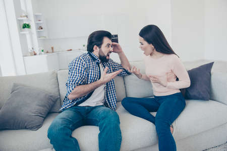 Aggressive negative couple screaming yelling to each other with wide open mouth gesturing with hands having fight scandal. Insults distrust disrespect concept