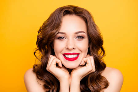 Closeup portrait of pretty elegant girl with straight white teeth modern hairstyle isolated on yellow background demonstrate perfect make up for event holiday birthday