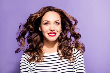 Portrait of gorgeous fancy girl enjoying sunlight sunshine wind blow looking away having flying hair isolated on violet background. Hair care treatment therapy concept Stock Photo