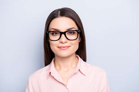 Portrait of clever charming brunette cute pretty woman in glasses, wearing classic shirt, looking at camera, isolated on grey background