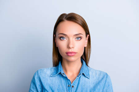 Portrait of pretty nice woman in jeans shirt with concentrated thoughtful expression isolated on grey background