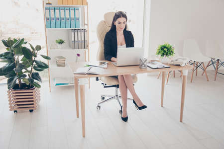Full size portrait of confident journalist stylish pretty accountant with glasses on head texting on laptop using wi-fi internet checking email working on project startup, telemarketing concept