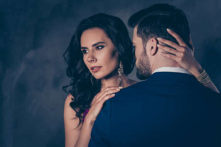 Portrait of pretty brunette lady with earring bonding touching secret mysterious gentlemen with bristle, lovely mr and mrs isolated on grey background Stock Photo