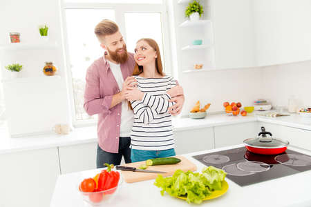 Joy happiness cuddling trust support understanding idyllic harmony concept. Portrait of romantic stylish couple in casual outfits bonding while preparing vegetable salad keeping healthy lifestyle