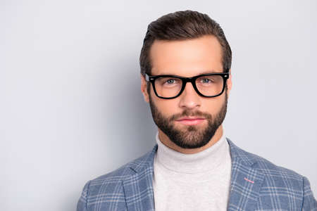 Portrait of gentlemen, manly, calm, intelligent man with serious expression, looking at camera over gray background Stok Fotoğraf