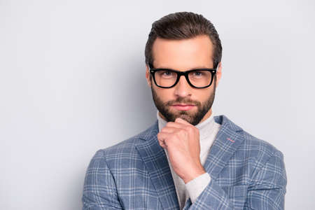 Ponder, minded, attractive manager with hairstyle in checkered jacket and  turtleneck, glasses, holding hand on chin, considering, standing over gray background Stok Fotoğraf - 106239507