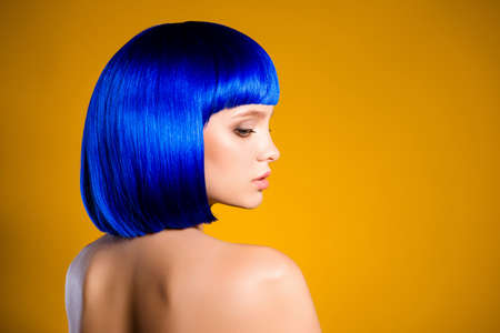 Profile portrait with copy space empty place for product of charming pretty woman in bright blue wig isolated on yellow background 스톡 콘텐츠