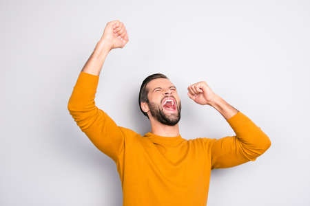 People leadership wonderment concept. Portrait of cheerful excited joyful careless handsome attractive delightful yelling shouting guy isolated on gray background Stock Photo
