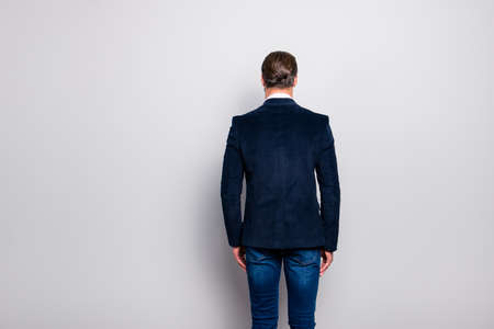 Rear back behind view photo of stunning well-dressed groomed brutal classic posh elegant modern handsome attractive entrepreneur, dark blue velvet blazer jeans, isolated on gray background copy-space
