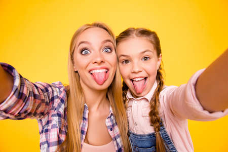 Close up photo portrait of comic funky rejoicing joking delightful cheerful beautiful with teeth cute carefree girls making photography isolated on bright vivid background Stock Photo