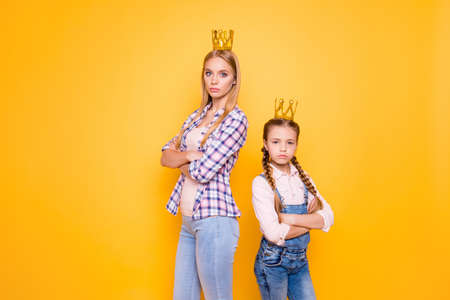 Portrait of confident narcissistic beautiful girls isolated on bright background Stock Photo