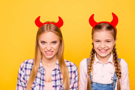 Teen age teenager adult concept. Close up portrait of little scaring funky beautiful cute girl with pigtails in overalls attractive terrifying with long hair woman isolated on bright vivid background