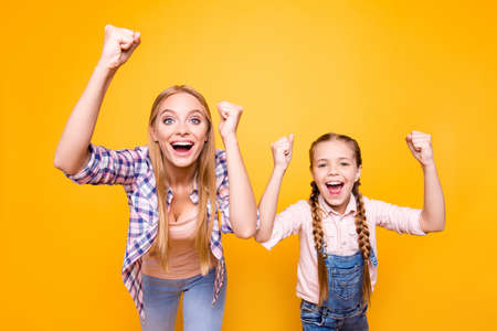 Yeah yes wow cool! Dreams come true! Different age face siblings mama mom mum mommy concept. Portrait of excited crazy joyful amazed cheerful girls with long hair isolated on bright vivid background Stock Photo