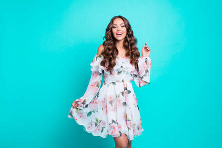 Photo portrait of attractive pretty cute lovable fascinating delicate alluring gorgeous nice stunning with long wavy hairdo shirt mini white dress holding frill chiffon isolated on vivid background Stock Photo