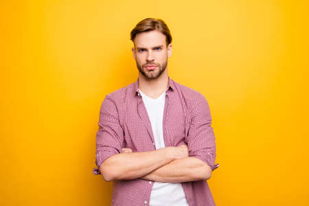 Bad day people person concept. Portrait of serious pensive focused sad upset handsome attractive virile masculine boy standing with crossed hands isolated on bright background copyspace cutout