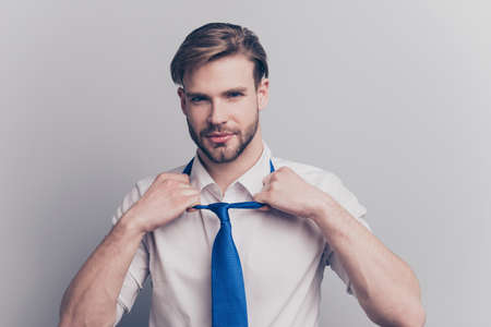 Leave off blue tie people person womens day boyfriend apparel clothes concept. Portrait of sexual hot romantic handsome tempting guy undressing taking off tie isolated on gray background copy-space