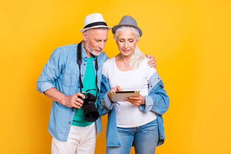 Paparazzi photo shooting studio profession holiday map take make picture concept. Portrait of thoughtful charming using modern technology old partners browsing internet isolated on bright background