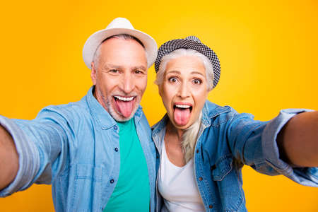 Lick hungry tasty hug embrace cuddle concept. Close up photo portrait of shocked impressed joyful excited cheerful rejoicing resting relaxing taking making selfie partners isolated bright background