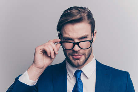 Suspicion proud respect distrust hesitate manipulate people person agent concept. Close up portrait of self-assured handsome confident recruiter touching glasses looking you isolated gray background