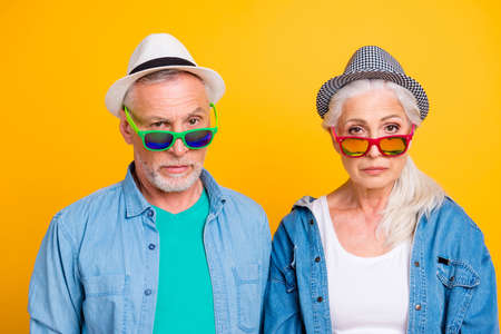 What? Let me think! Young vs old person lifestyle concept. Close up photo portrait of two minded amazed surprised thoughtful pondering granny granddad in green red eyewear isolated bright background