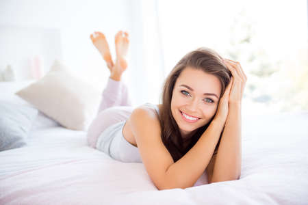 Portrait of cheerful positive girl lying on bed enjoying perfect morning time st home day health healthy good life nap daydreaming