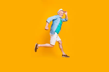 Happiness emotion facial expressing hold hand empty place concept. Turned full length size view photo portrait of cheerful excited lovely cute handsome gentleman jumping up isolated vivid background