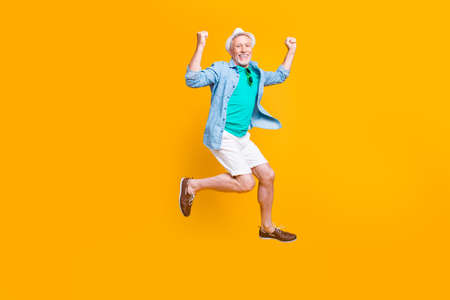 Headwear spectacles green glasses freedom happiness modern motion grey hair summer concept. Full length size photo portrait of cheerful careless funky funny runner isolated on vivid background Stock Photo
