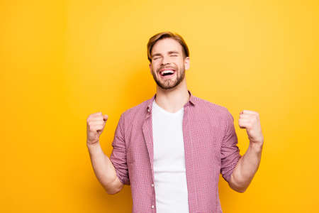 Come true want wish desire best leader leadership people person concept. Portrait of excited cheerful rejoicing delightful ambitious proud  guy raising fists up isolated on bright background copyspace 스톡 콘텐츠
