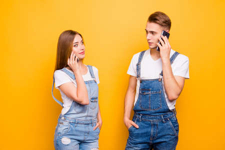 He and she jealous people concept. Close up photo portrait of handsome gentleman pretty lady holding cellular near ear listening to subscriber operator call center isolated bright background Banque d'images