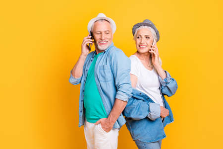 Listen disturb eavesdrop noise people jeans style stylish outfit concept. Photo portrait of excited cheerful delightful peaceful sweet lovely subscribers speakers talking on cell isolated background Stock Photo