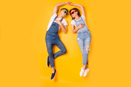 Unity married partners denim casual clothes concept. Above high-angle full length size photo portrait of two excited cheerful joyful cute sweet people enjoying looking time isolated bright background