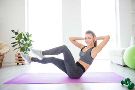Day lifestyle style trend gymnastics practicing motion concept. Side profile view photo portrait of beautiful attractive sporty purposeful sportive lady wearing sport clothes doing crunches in air