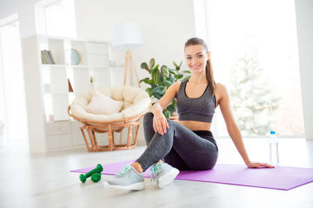 Portrait of beautiful attractive pretty delightful sexual coach trainer lady going to gym after work having rest after exercise wearing gray tight pants clothes leggings