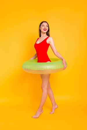 Travel tourism tourist resort lifestyle leisure dream dreamy people person concept. Vertical full length size body photo portrait of lovely girl with green lifebuoy isolated bright background