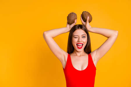 Trip leisure happiness delight game easter people person concept. Close up photo portrait of funny funky pretty comic joyful glad nice lady grimacing holding fruits on head isolated bright background Stock Photo