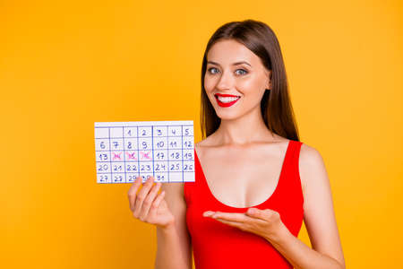Appointment business meeting celebrate people person concept. Closeup photo portrait of confident pretty cute nice beautiful gorgeous lady holding calendar in hand isolated vivid bright background Stock Photo